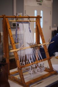 Loom ready to begin weaving by volunteers