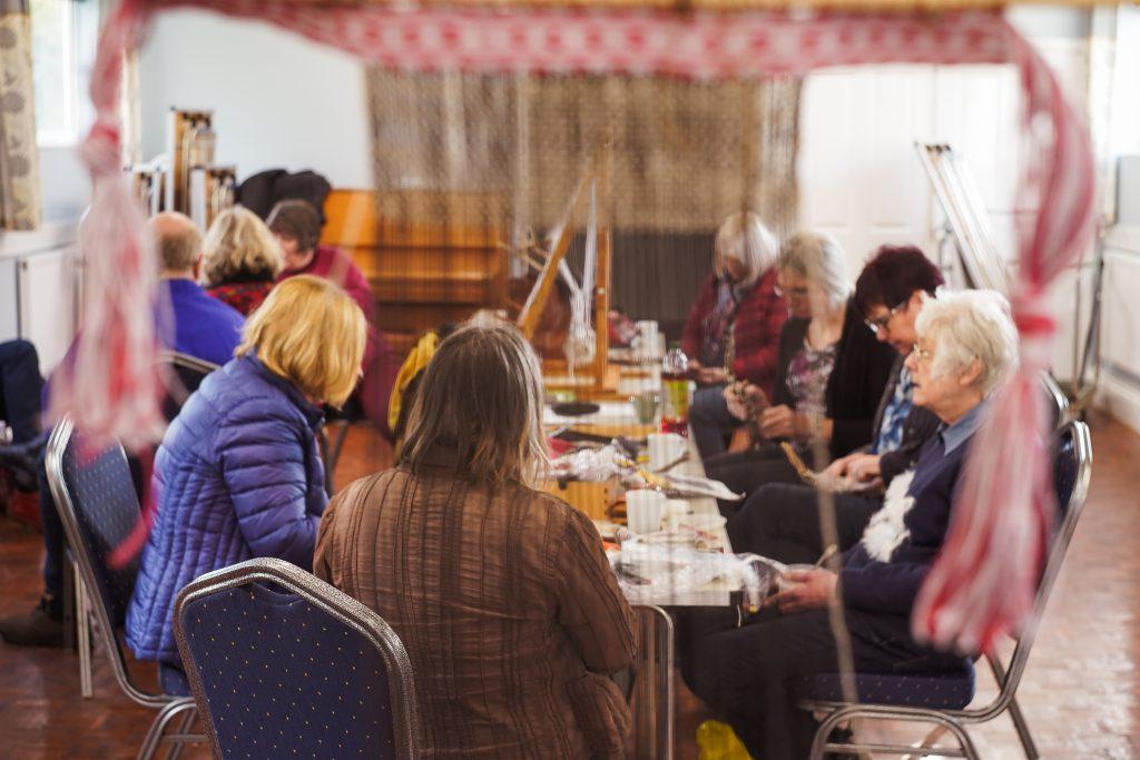 Volunteer weavers at a flax workshop