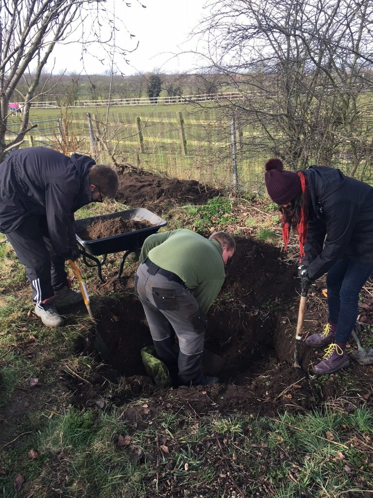 People digging a wildlife pond at Wroot Primary