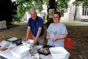 Showing how to wash finds from an archaeological dig