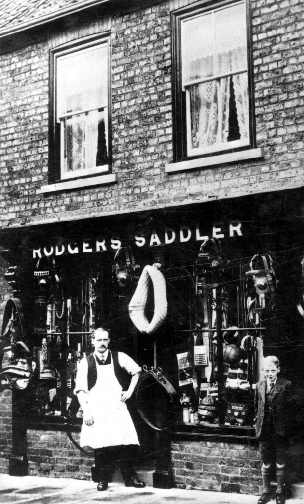 Wilf Rogers outside his saddlers shop in Epworth circa 1910.